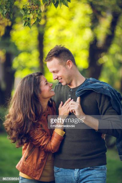 Romantic couple in autumn park- love, dating, romance.