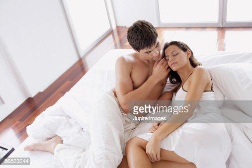 Romantic couple in bed   Stock Photo. Romantic Couple In Bed Stock Photo   Getty Images