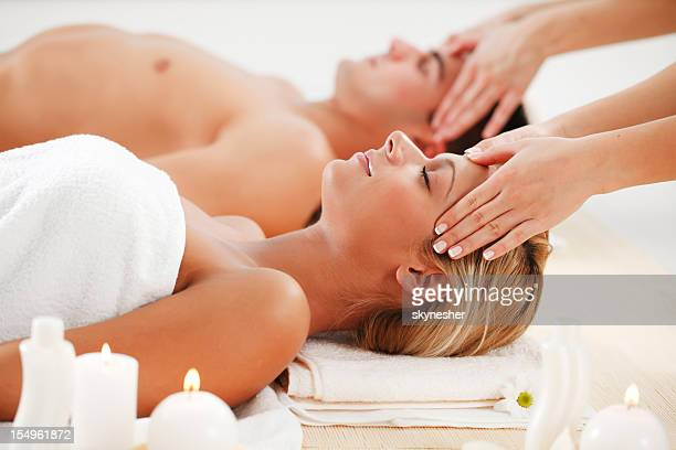 Romantic couple is having a head massage at spa centre.