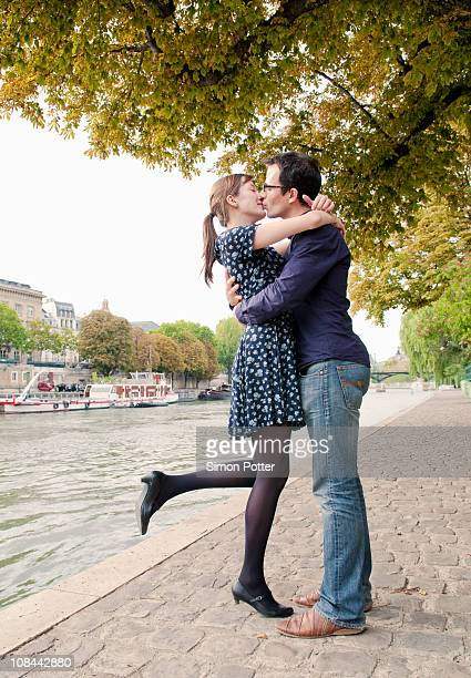 Romantic couple kiss by river Seine