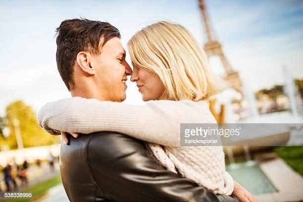 romantic couple kissing at sunlight on Paris