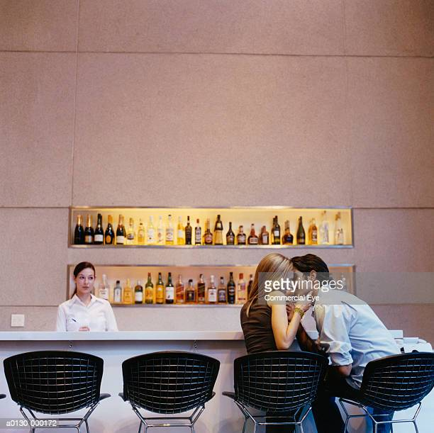 Romantic Couple Kissing in Bar