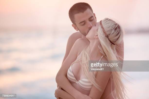 Romantic couple kissing on the beach
