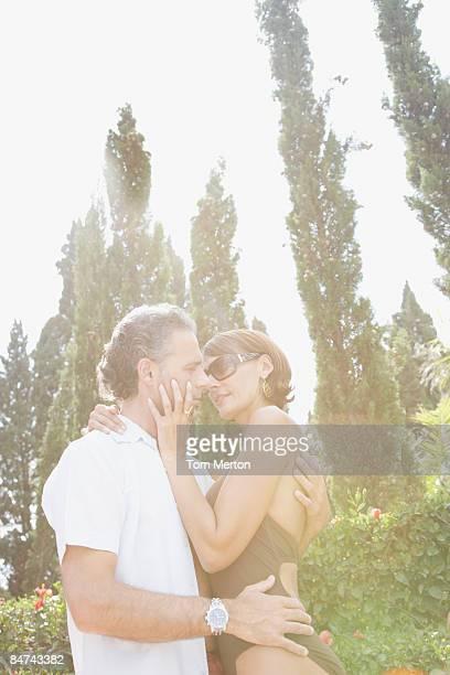 Romantic couple kissing outdoors