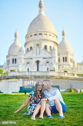 Romantic couple near Sacre-Coeur cathedral on Montmartre, Paris : Stock Photo