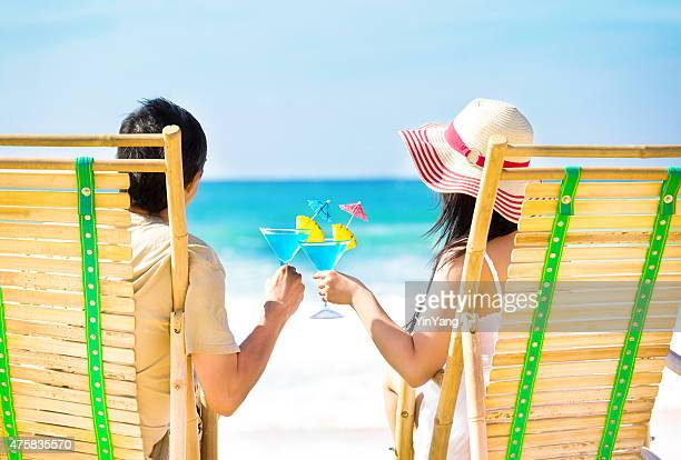 Romantic Couple on Beach with Tropical Drink in Hawaii