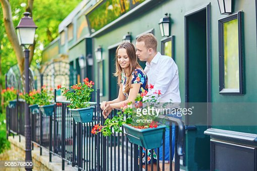 Romantic couple on the balcony decorated with flowers : Stockfoto