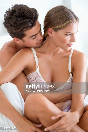 Romantic couple on the bed   Stock Photo. Romantic Couple On The Bed Stock Photo   Getty Images