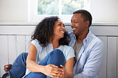 Romantic Couple Relaxing In Chair At Home