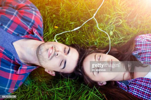 Romantic Couple Sharing Ear Buds