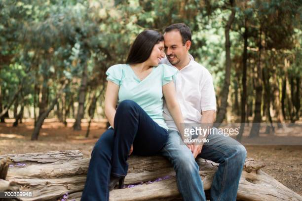 Romantic couple sitting and smiling at each other