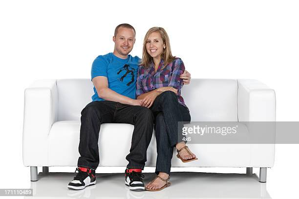 Romantic couple sitting on a couch