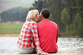 Romantic couple sitting on a jetty