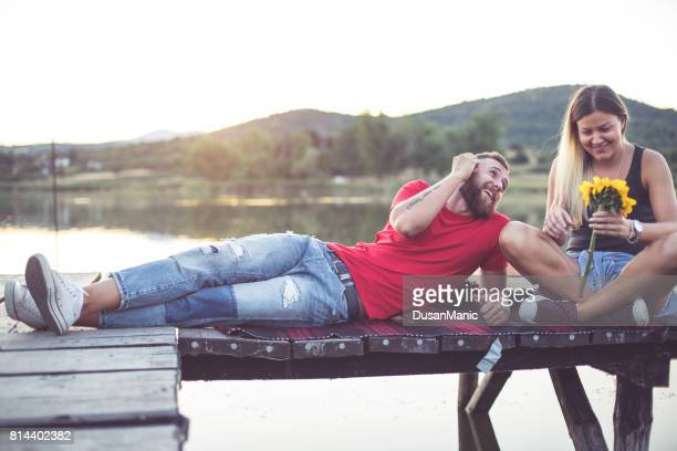 Romantic Couple sitting on the pier