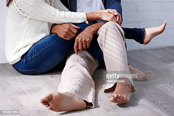 Romantic couple sitting together on floor