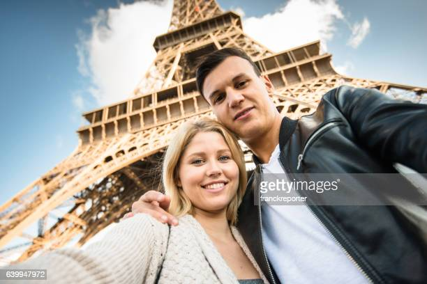 romantic couple take a selfie in paris