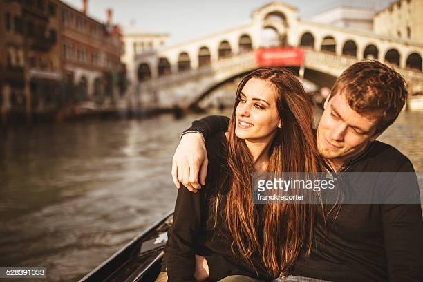 romantic couple togetherness on the gondola in venice