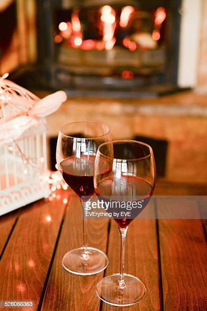 Romantic dinner by the fireplace with wine