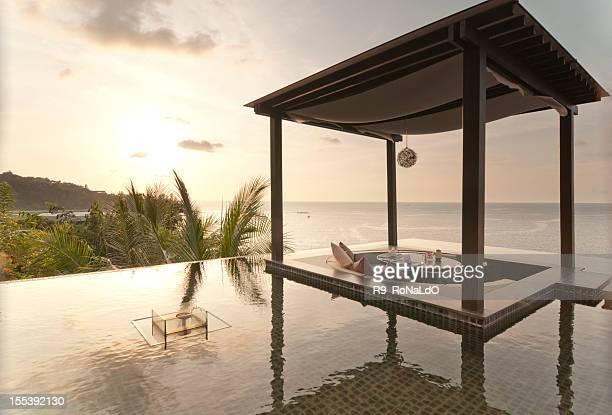 Romantic dinning table at sunset beach