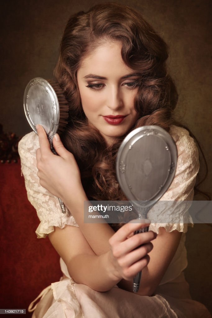 romantic girl combing her hair : Stock Photo