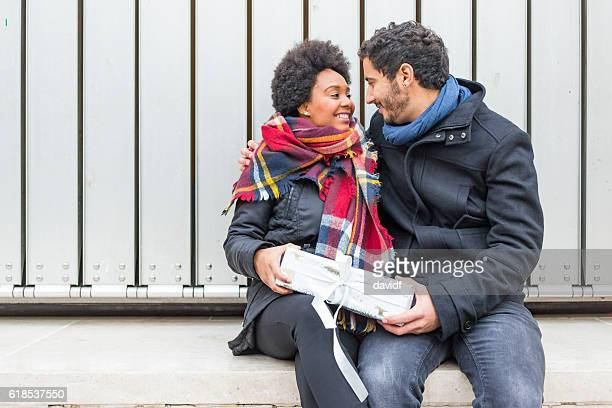 Romantic Hipster Couple Giving Christmas Gifts