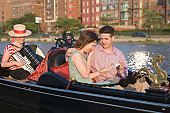 Romantic Hispanic couple in a gondola, Boston, Massachusetts, USA