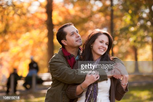 Romantic Hispanic couple in a park : Foto de stock