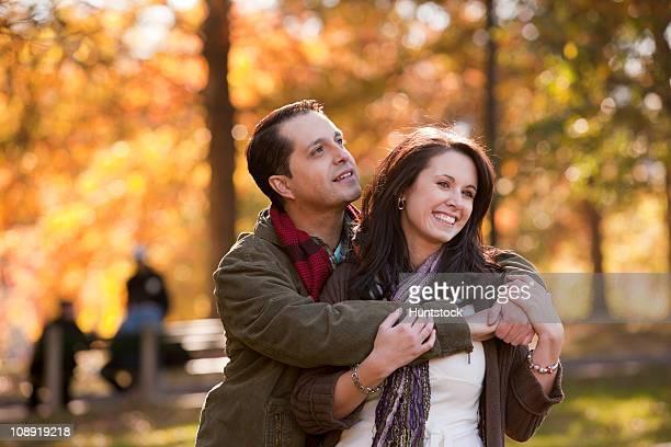 Romantic Hispanic couple in a park