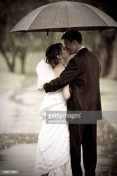 romantic kiss under the rain