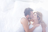 Picture of two romantic lovers kissing in bed