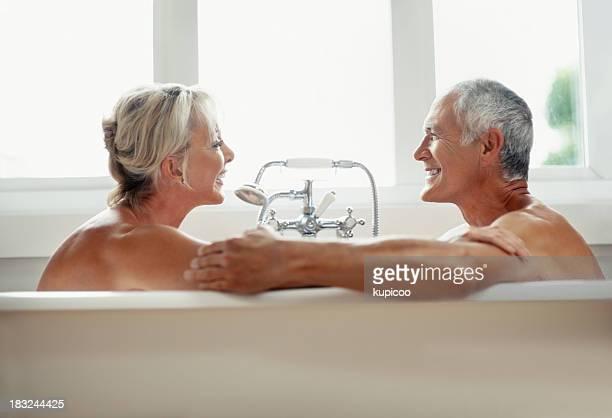 Romantic mature couple enjoying and having fun in bathtub