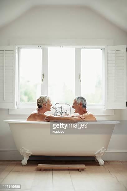 Romantic, mature couple having fun in a bathtub