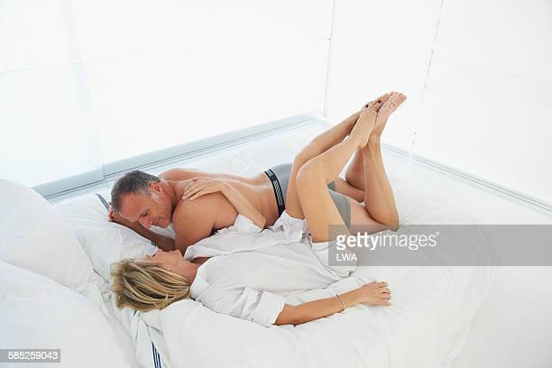 Romantic mature couple on bed