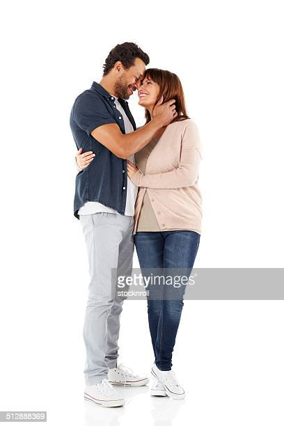 Romantic mature couple together over white