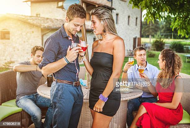 Romantic moment: couple together with friends