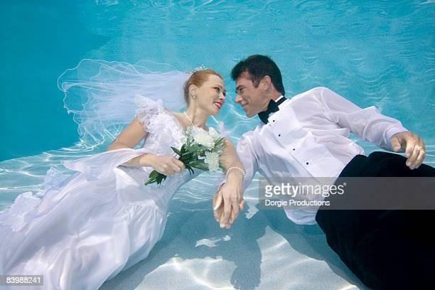 Romantic newlyweds underwater