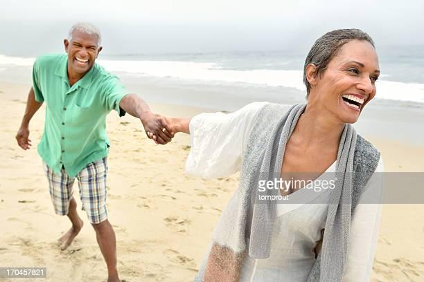 Romantic Senior Couple Playing on Beach