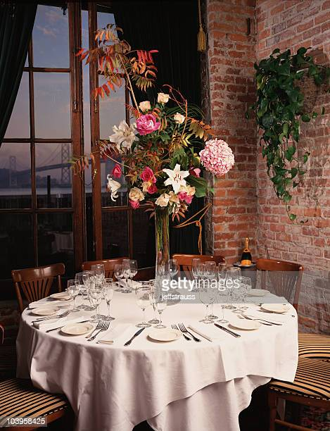 romantic table with bridge in background