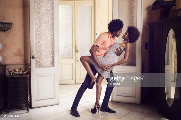 romantic young couple dancing at home