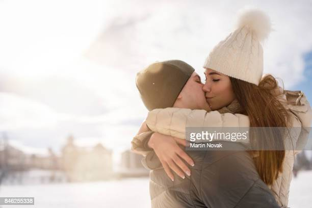 Romantic young couple embrace while kissing