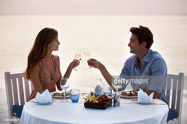 Romantic young couple having dinner in the beach