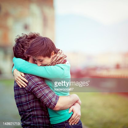 Romantic young couple hugging : Stock Photo