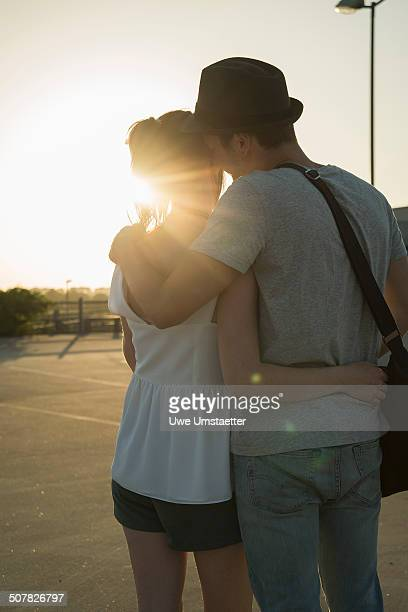 Romantic young couple in empty parking lot