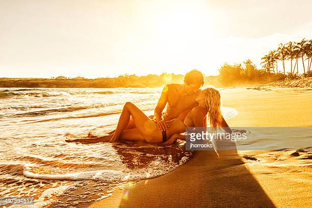 Romantic Young Couple on Beach at Sunset