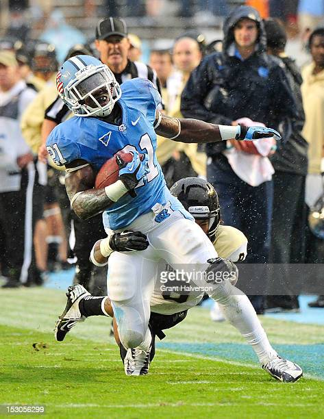 Romar Morris of the North Carolina Tar Heels breaks away from Gary Walker f the Idaho Vandals during play at Kenan Stadium on September 29 2012 in...