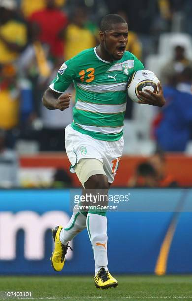Romaric of the Ivory Coast celebrates scoring his side's second goal during the 2010 FIFA World Cup South Africa Group G match between North Korea...
