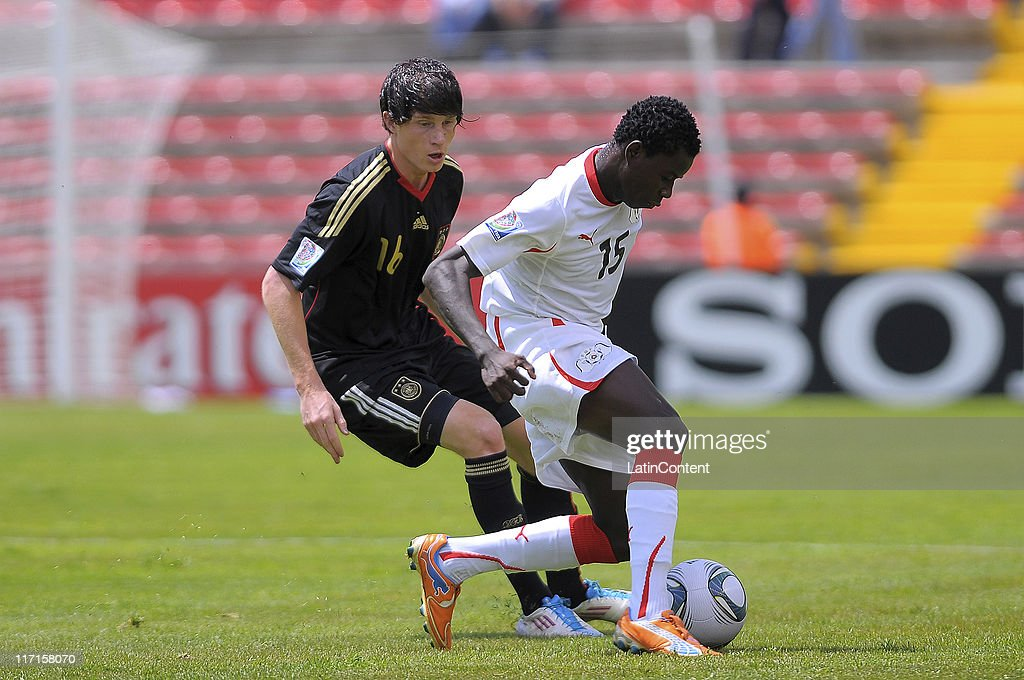 Romaric Pitroipa (R) of Burkina Faso struggles for the ball with Sven Mende (L) of Germany during the FIFA U-17 World Cup Mexico 2011 Group E match between Burkina Faso and Germany at the Corregidora Stadium on June 23, 2011 in Queretaro, Mexico.