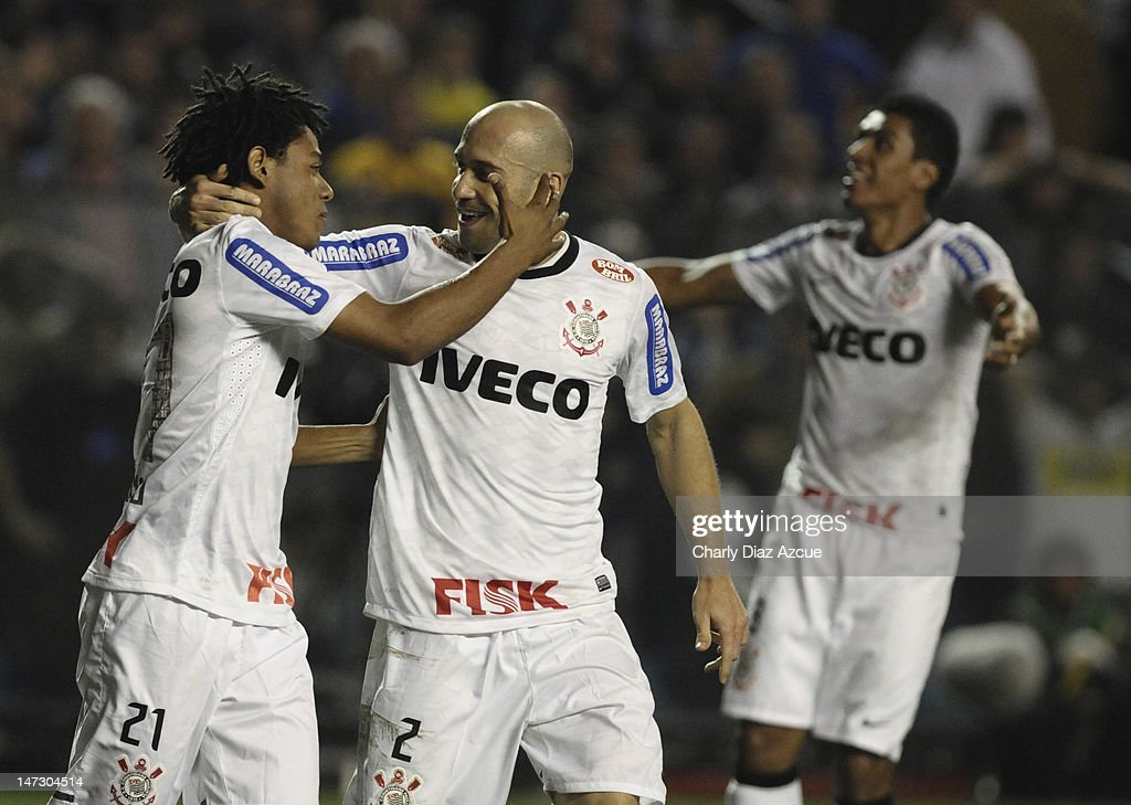 Romarinho (L) and Alessandro (R) of Corinthians celebrates a goal during a match between Boca Juniors and Corinthians as part of the first leg of the Libertadores Cup 2012 finals at the Bombonera Stadium on June 27, 2012 in Buenos Aires, Argentina.