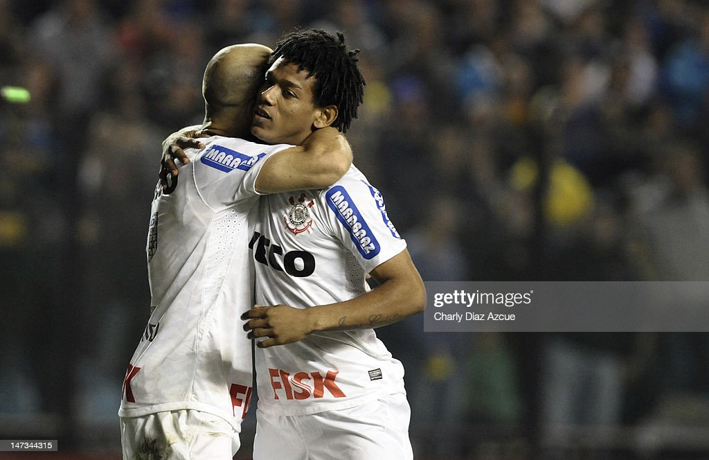 Romarinnho (R) and Alessandro (L) of Corinthians celebrate a goal during a match between Boca Juniors and Corinthians as part of the finals of the Copa Libertadores 2012 at Bombonera Stadium on June 27, 2012 in Buenos Aires, Argentina.