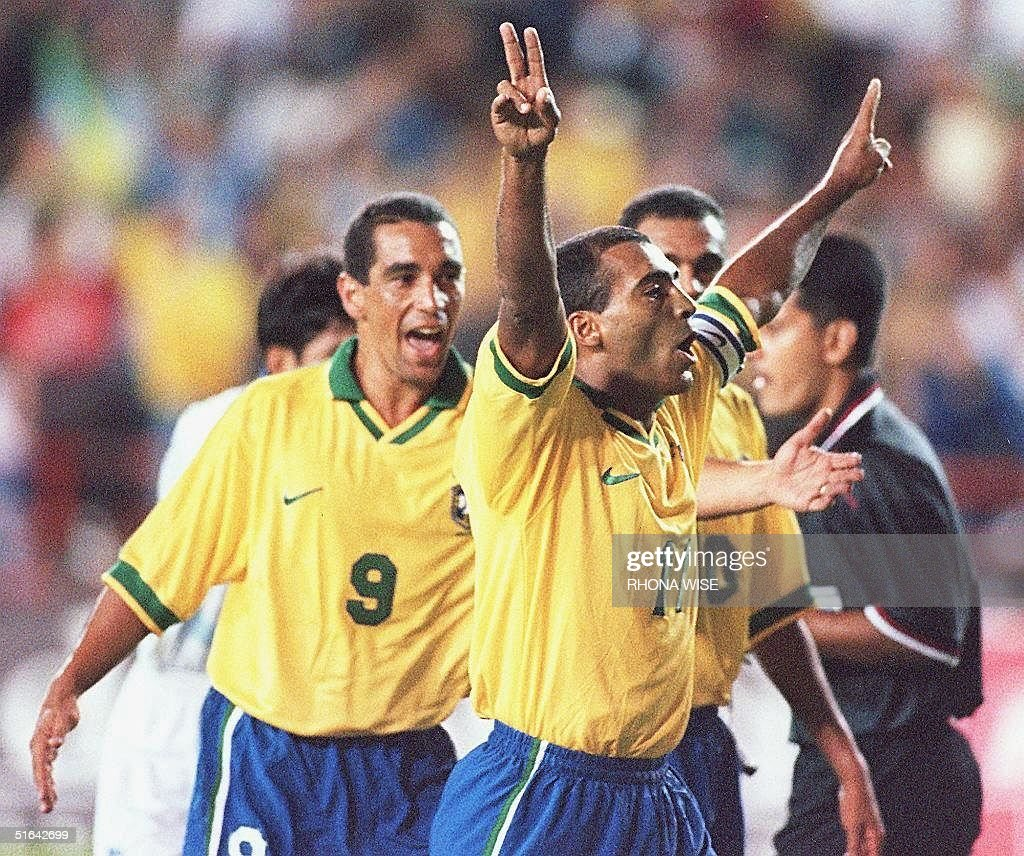 Romario of Brazil C celebrates scoring a penalty